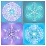 Set Of Circle Lacy Patterns. Four round symmetric lacy ornaments. Line art doodles. Fragile elements on vivid colorful square backgrounds Stock Image