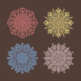 Set of 4 circular pattern radial heart flowers snowflakes multic Stock Photo