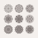 Set of 9 circular pattern radial heart flowers snowflakes on a w Stock Images