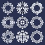 Set of circular patterns in Asian intersecting lines style. Nine white eight pointed mandalas in snowflakes form. On blue background stock illustration