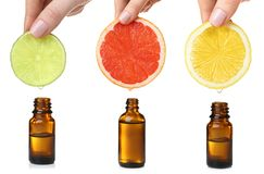 Set with citrus essential oils. On white background royalty free stock image