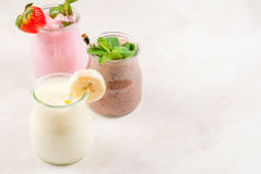Set of classic milkshakes in small jars stock images