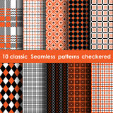 Set of 10 classic seamless checkered patterns. White, orange and black colors Stock Image
