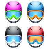 Set of Classic Ski helmets and snowboard goggles. Royalty Free Stock Images