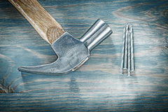 Set of claw hammer nails on vintage wooden board construction co Stock Image