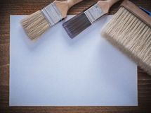 Set of clean sheet of paper and paint brushes Stock Images