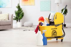 Set of cleaning supplies on floor. Indoors stock photos