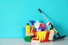 Set of cleaning supplies. On table indoors stock photography