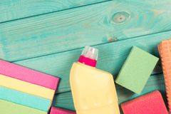Set of cleaning up stuff on blue wooden background. Royalty Free Stock Photos