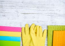 Set of cleaning up stuff on wooden background. Royalty Free Stock Photography