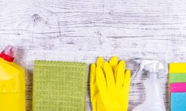 Set of cleaning up stuff on wooden background. Royalty Free Stock Image