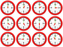 Set of clocks. Set of red wall-clocks with different time Royalty Free Stock Photography