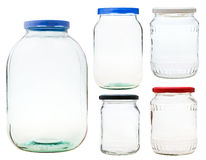 Set of closed glass jars isolated on white Stock Photos