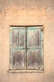 A set of closed  shutters. A Set of Closed Shutters in a poor area of France Stock Image