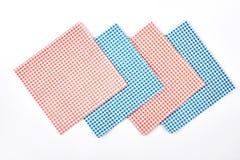 Set of cloth vintage napkins. Four checkered retro table napkins on white background. Collection of tablecloth napkin, top view Stock Photo