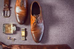 Businessman accessories. Man`s style. Men`s Accessories. A set of clothes for the groom. Wedding shoes, belt, tie, perfume, cufflinks. The whole set of men is Stock Image