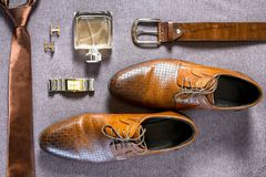Businessman accessories. Man`s style. Men`s Accessories. A set of clothes for the groom. Wedding shoes, belt, tie, perfume, cufflinks. The whole set of men is Royalty Free Stock Image