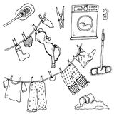 Set of clothes. The laundry is dried in the fresh air. Vector illustration. Funny things are added to the clothesline. Cheerful illustration for design with Royalty Free Stock Photo