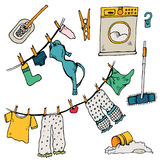 Set of clothes. The laundry is dried in the fresh air. Vector illustration. Funny things are added to the clothesline. Cheerful illustration for design with Stock Images