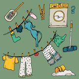 Set of clothes. The laundry is dried in the fresh air. Vector illustration. Funny things are added to the clothesline. Cheerful illustration for design with Stock Photos