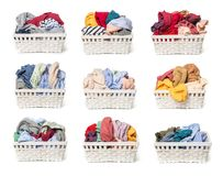 Set of Clothes in a laundry wooden basket isolated on white background royalty free stock photos