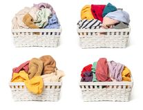 Set of Clothes in a laundry wooden basket isolated on white background royalty free stock image