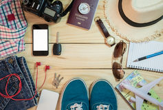 Set of clothes and travel accessory Stock Photos