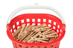 Set of clothespins in the red basket. Stock Images