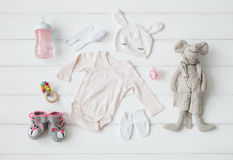 Set of clothing and items for a baby. Set of clothing and items for a newborn baby stock images