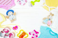 Set of clothing and items for a newborn baby placed on board royalty free stock images