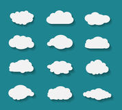 Set of clouds in flat design with flat shadows on blue background Stock Photo