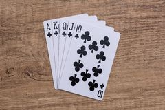 Set of Clubs suit playing cards. On wooden desk Stock Photography