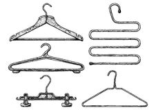 Set of coat hanger. Vector black-and-white hand drawn illustration of clothes coat-hanger set in vintage engraved style. Wooden, plastic and wire coathangers vector illustration