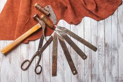 Set of cobbler tools on the light wooden background. Space for t. Set of cobbler tools on a light wooden background. Space for text royalty free stock photography