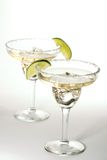 Set of cocktails with ice in Martini glasses. Set of martini glasses with cocktails over paper background served with lime Royalty Free Stock Photography