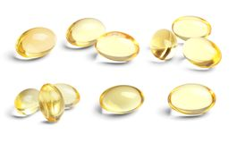 Set with cod liver oil pills. On white background stock image
