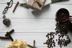 Set of coffee beans and chocolate sweets and packs and pocket watch. White wooden background Royalty Free Stock Photography