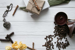 Set of coffee beans and chocolate sweets and packs and pocket watch. White wooden background Royalty Free Stock Image