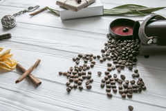 Set of coffee beans and chocolate sweets and packs and pocket watch. White wooden background Stock Photography