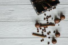Set of coffee beans and chocolate sweets. White wooden background Royalty Free Stock Images