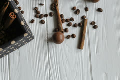Set of coffee beans and chocolate sweets. White wooden background Stock Photo