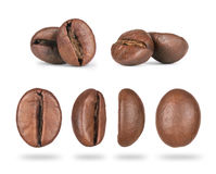 Set of coffee beans close-up in different positions. Isolated on white background royalty free stock photos