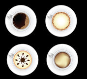 Set of coffee cups isolated on black. Set of decorated coffee cups isolated on black background Royalty Free Stock Photos
