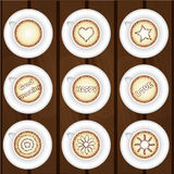 Set of coffee cups on wooden background Royalty Free Stock Photos