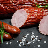 Set of cold cuts. On a wooden board. Mix of sausages stock photo