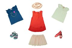 Set or collage of little girl clothes for day of the child. Colo stock images