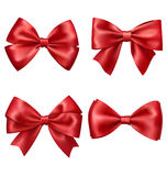 Set Collection of Festive Red Satin Bows  on White. Background Royalty Free Stock Photos