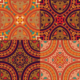 Set collection of four colorful tribal ethnic seamless patterns. Royalty Free Stock Images