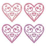 Set collection of ornamental pink glitter hearts on a white background. Royalty Free Stock Images