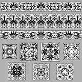 Set collections of old Greek ornaments. Antique borders and tiles  in black and white colors. Isolated on gray background. Ethnic patterns. Vector illustrations Stock Images